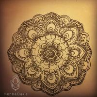 Henna-style artwork on paper